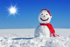 Snowman. On blue sky background Royalty Free Stock Photos
