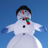 Snowman on blue sky Stock Images