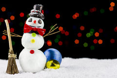 Snowman on bokeh lights background Stock Image