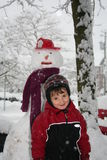 Snowman and boy Royalty Free Stock Photos