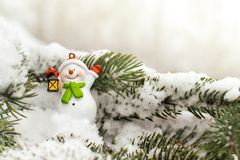 Snowman on a branch of a Christmas tree. Christmas. New Year.  Stock Photos