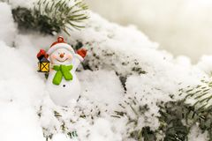 Snowman on a branch of a Christmas tree. Christmas. New Year Stock Photo