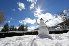 Snowman on a bright day Stock Photos