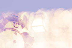 Snowman on bright shiny bokeh background Royalty Free Stock Image