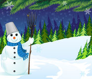 Snowman with a broom and bucket Royalty Free Stock Photography
