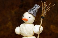 Snowman with broom in hand Royalty Free Stock Images