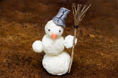 Snowman with broom in hand Stock Photos