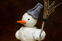 Snowman with broom in hand royalty free stock image