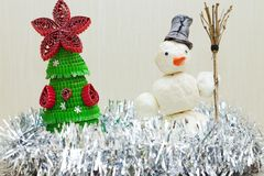 Snowman with broom in hand Stock Photo