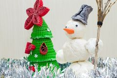 Snowman with broom in hand Royalty Free Stock Photography