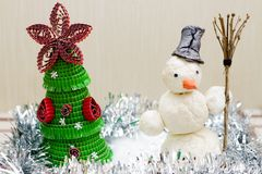 Snowman with broom in hand royalty free stock photos
