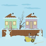 Snowman with a broom and hand snowplow Stock Photo