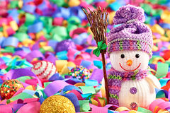 Snowman with broom and serpentine Royalty Free Stock Photos