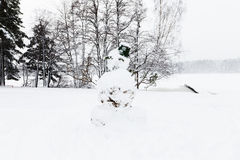 Snowman with bucket on the head Royalty Free Stock Image