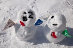 Snowman build by snow with big smile. In winter season stock photography