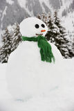 Snowman Built in Alpine Location Stock Photo