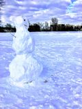Snowman built at recess royalty free stock images
