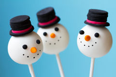 Snowman cake pops. Against blue Stock Image
