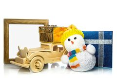 Snowman with car, gift boxes and frame Royalty Free Stock Image