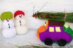 Snowman, car and pine tree Stock Photo