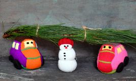 Snowman, car and pine tree Royalty Free Stock Images
