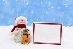Snowman with a card Stock Photo