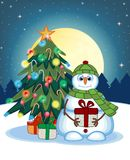Snowman Carrying A Gift And Wearing A Green Head Cover And A Scarf With Christmas Tree And Full Moon At Night Background For Your Royalty Free Stock Images