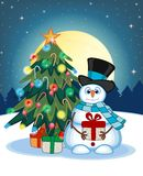 Snowman Carrying A Gift Wearing A Hat And A Blue Scarf With Christmas Tree And Full Moon At Night Background For Your Design Vecto Stock Image