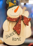 Snowman carved in wood. Royalty Free Stock Image