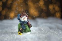 Snowman ceramic figure. Christmas decoration on blured background Stock Photos