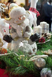 Snowman ceramic figure. Christmas decoration with pine branch and christmas balls in foreground Stock Photo