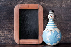 Snowman and chalk boards. Christmas decorations Stock Photography