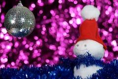 Snowman and christmas ball Royalty Free Stock Photography