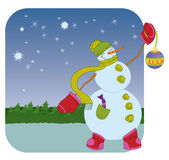 Snowman with Christmas ball on winter background Stock Image
