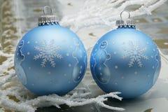 Snowman christmas balls. Two blue christmas balls with snowmen. Still life illuminated with Dedo-light spots Stock Images