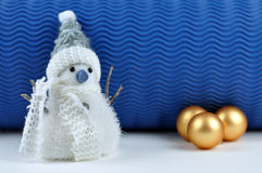 Snowman and Christmas Balls. Snowman and golden Christmas balls with a blue background Stock Photo