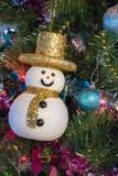 Snowman and Christmas Balls on Christmas Tree Stock Image