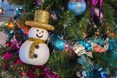 Snowman and Christmas Balls on Christmas Tree Royalty Free Stock Photography