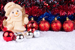 Snowman and christmas balls on snow. Snowman figure in snow  and christmas balls - christmas decoration Royalty Free Stock Images