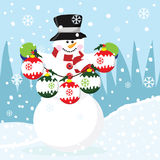 Snowman with Christmas Bauble Royalty Free Stock Images