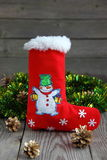 Snowman. Christmas boot, snowman, tinsel and spruce royalty free stock photo