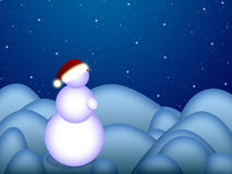 Snowman with christmas cap is standing Royalty Free Stock Photography