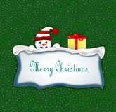 Snowman. The Christmas card with the snowman on green background Royalty Free Stock Images