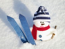 Snowman - Christmas card. Snowman with ski - Christmas card : cute toy on snow Background - Outdoors royalty free stock image