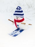 Snowman - Christmas card. Snowman with ski - Christmas card : funny toy ornament on snow Background - Outdoors royalty free stock photography