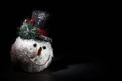Snowman christmas decoration. Snowman head christmas decoration with black background Stock Photography