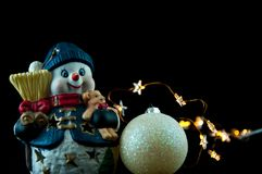 Snowman and Christmas decoration. Snowman and Christmas decoration isolated on black Stock Photography