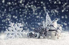 Snowman with christmas decoration and ornaments - jingle bells star snowflakes in snowy atmosphere. Stock Image