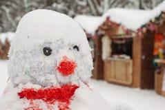 Snowman at Christmas fair with kiosk Stock Images