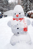 Snowman at Christmas fair with kiosk Royalty Free Stock Photos